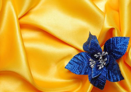 sateen: Christmas decoration on golden sateen with blue  flower