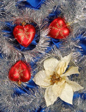 sateen: Blue sateen with three hearts decoration Stock Photo