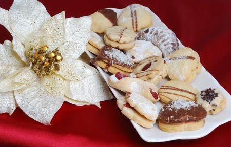 sateen: Christmas cakes situated on red sateen