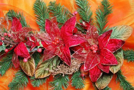 sateen: Christmas decoration on golden sateen with flowers Stock Photo