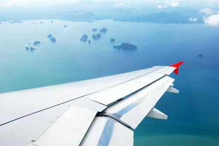 View of plane window on Thai islands photo