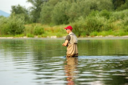 Fisherman angling on the river photo