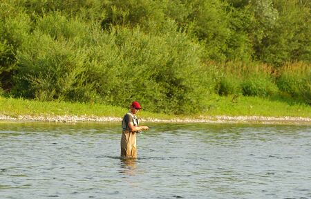 Fisherman angling on the river Stock Photo - 4408918