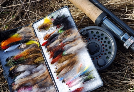 A collection of fly fishing flies and fly fishing rod Stock Photo