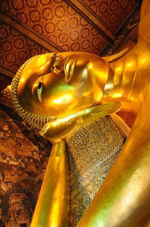 Statue of golden buddha in Bangkok grand palace  photo