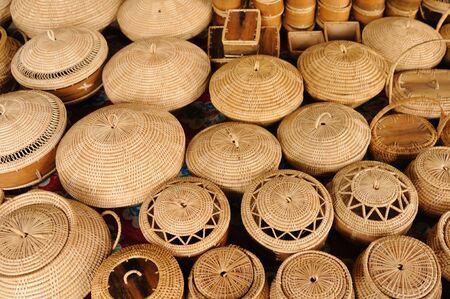 Straw backets on market in cambodia photo