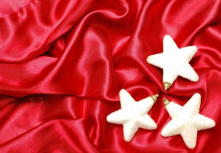 sateen: Christmas decoration on red sateen with big stars