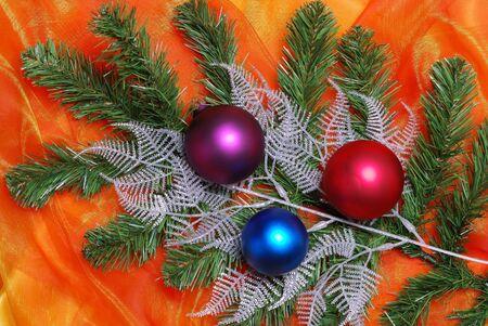 sateen: Christmas decoration on orange sateen with flowers
