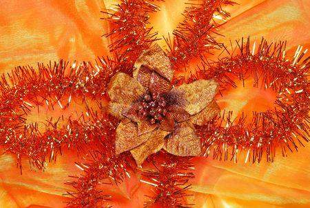 sateen: Christmas decoration on orange sateen