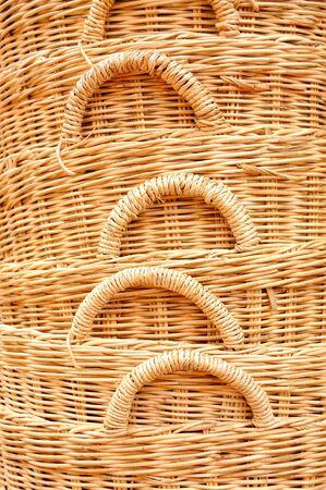 Straw baskets on market in cambodia photo