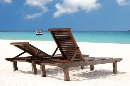 Two beach chairs on perfect tropical white sand  photo