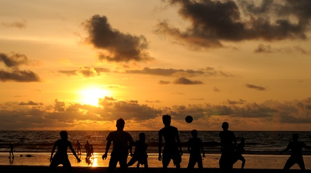 Football playing during sunset photo