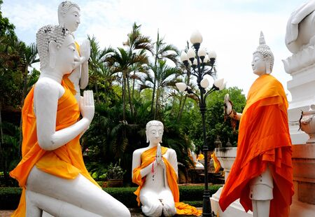Buddha statues with orange bands  Stock Photo