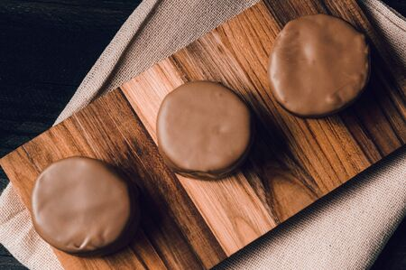 traditional sweet argentinian chocolate biscuit over a black table with a tablecloth Reklamní fotografie