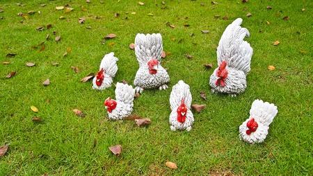 Chicken sculpture family on the grass floor