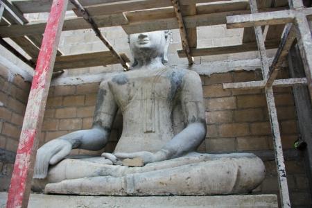Under construct Buddha statue