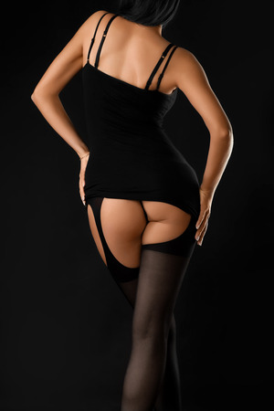 ass in lingerie on a black background