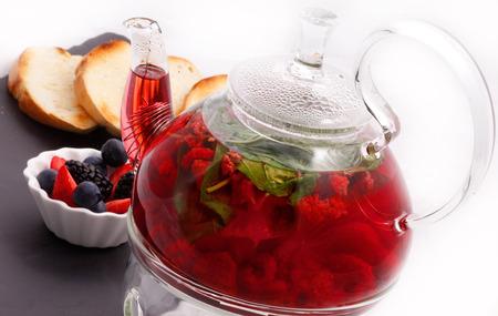 Berry tea with glass teapot and toast Standard-Bild