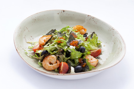 arugula salad with shrimp , cheese , black olives decorated with caviar.