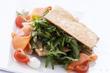 millefeuille of salmon and arugula Standard-Bild