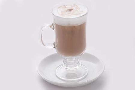 capucinno: cappuccino latte in a transparent glass on a white background