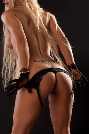Beautiful ass girl on a black background