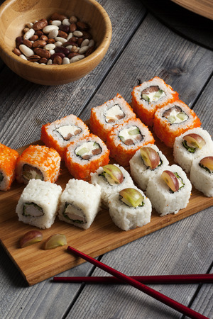 set of sushi on a wooden panel