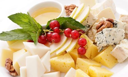 Verschiedene Obst und Käse, Honig und Nüssen Lizenzfreie Bilder