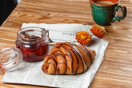 Fresh breakfast of croissants with chocolate syrup