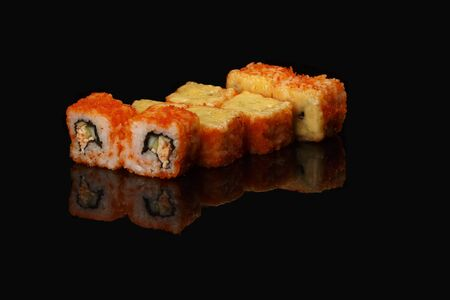 various sushi, rolls on a black background with reflection. especially for cafes and restaurants Stock Photo - 125947851