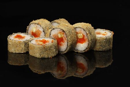 various sushi, rolls on a black background with reflection. especially for cafes and restaurants Stock Photo - 128654437