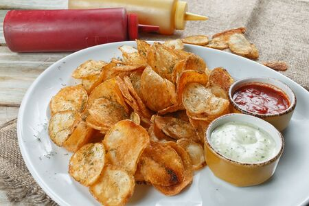 homemade potato chips with sauces