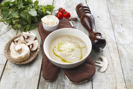 Mushroom cream soup on a wooden table.