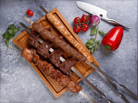 various kebabs on a gray stone background