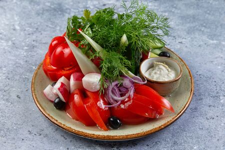 assorted vegetables in a plate on a gray background