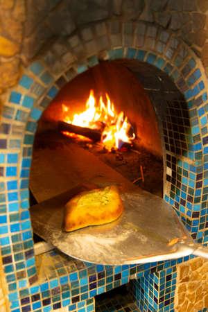 Cooking khachapuri (traditional Georgian dish) in the oven