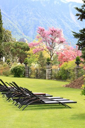 Chaise lounges on a lawn of the Alpine sanatorium Stock Photo