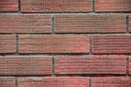 Aging wall from red brick Stock Photo