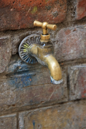 Old bronze water tap
