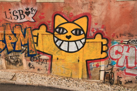 Lissabon, Portugal, November 5, 2013  Anonymous graffiti image shows merry cat ready to embrace you  Graffiti is located in old city