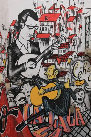 Lissabon, Portugal, November 5, 2013  Anonymous graffiti image shows singer traditional portuguese fado  Graffiti is located in old city
