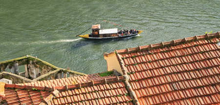 OPORTO, PORTUGAL - OCT 29, 2013  Ancient town in Portugal  Old boat convey the excursions a tourist on the Douro river  October 29, 2013