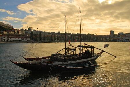 Boats with tun of portwine on river Douro  Porto, Portugal  Stock Photo