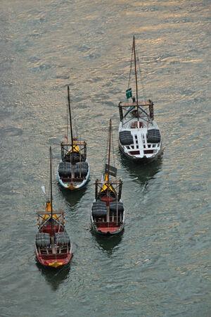 rabelo: Boats with tun of portwine on river Douro  Porto, Portugal  Editorial