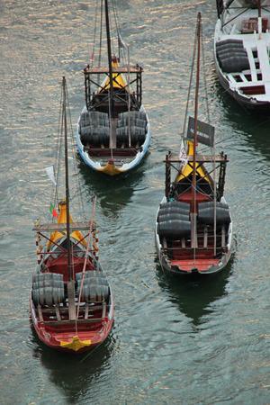 Boats with tun of portwine on river Douro  Porto, Portugal  Editorial