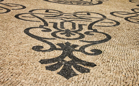 Traditional marble mosaic on street in Lisbon  Portugal