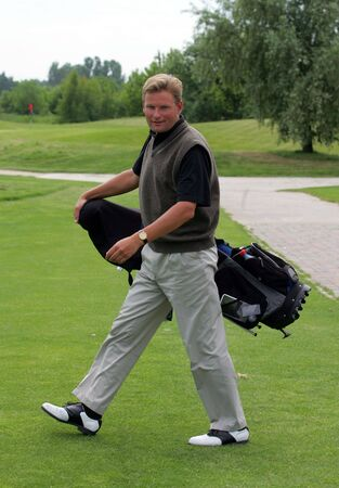 Golfer with bag photo