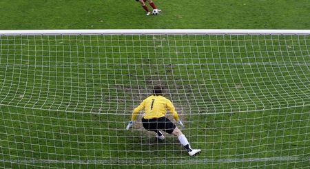 Soccer goalkeeper (goalie) in action.