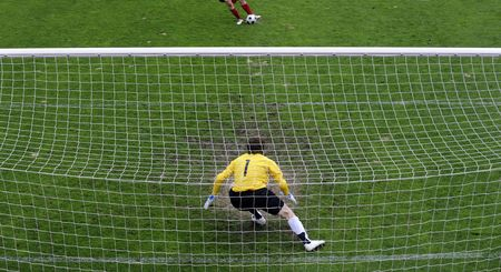 soccer goalkeeper: Soccer goalkeeper (goalie) in action.