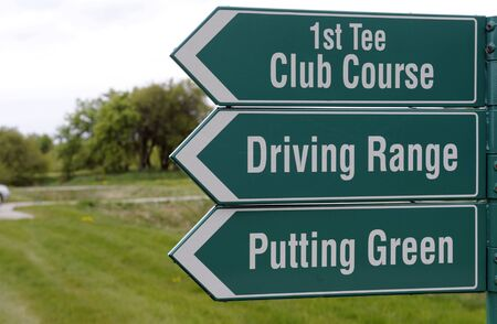 Three green signs at the golf course Stock Photo